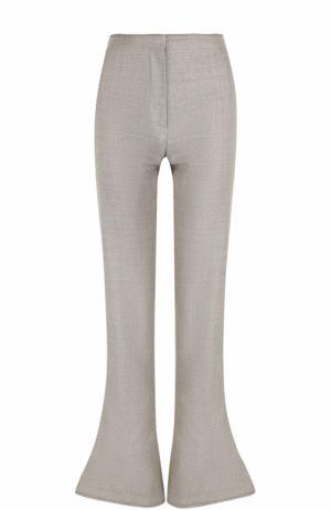 Шерстяные расклешенные брюки Acne Studios. Цвет: бежевый