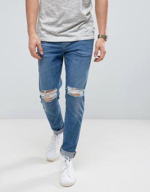 ASOS Синие выбеленные зауженные джинсы с рваной отделкой из ткани плотнос. Цвет: синий