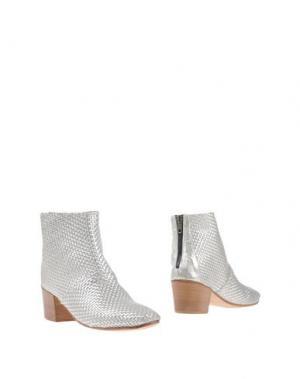 Полусапоги и высокие ботинки KUDETÀ. Цвет: серебристый