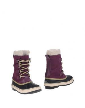 Полусапоги и высокие ботинки SOREL. Цвет: темно-фиолетовый