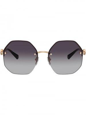 Солнцезащитные очки в геометричной оправе Bulgari. Цвет: золотистый