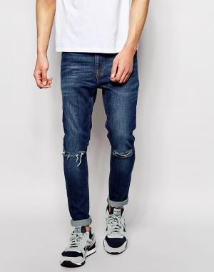 Супероблегающие джинсы с рваными коленями ASOS DESIGN. Цвет: синий