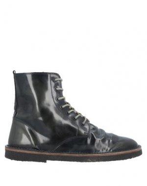 Полусапоги и высокие ботинки GOLDEN GOOSE DELUXE BRAND. Цвет: черный