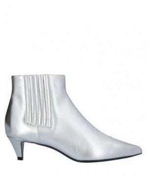 Полусапоги и высокие ботинки CELINE. Цвет: серебристый