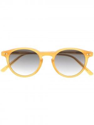 Солнцезащитные очки Castore в круглой оправе Epos. Цвет: желтый