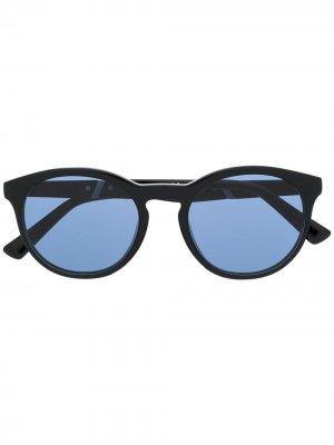 Солнцезащитные очки в круглой оправе с затемненными линзами Diesel. Цвет: черный