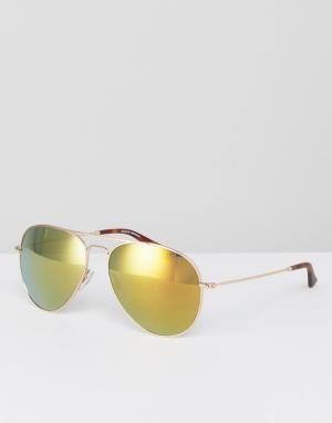 Солнцезащитные очки-авиаторы в золотистой оправе Levis. Цвет: золотой