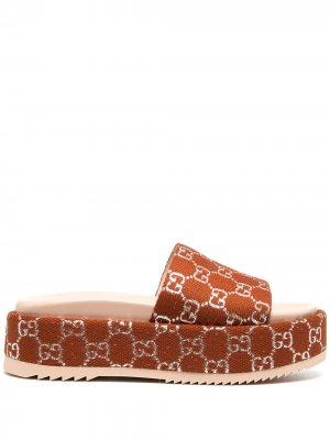 Сандалии на платформе Gucci. Цвет: коричневый