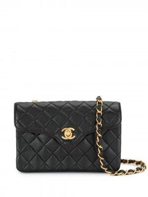 Стеганая мини-сумка на плечо 1992-го года с логотипом CC Chanel Pre-Owned. Цвет: черный