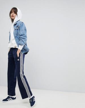 Темно-синие широкие брюки adidas Originals. Цвет: темно-синий