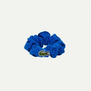 Резинка для волос Lacoste. Цвет: синий