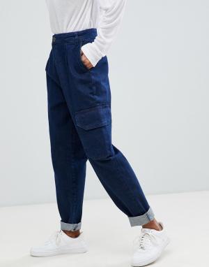 Суженные книзу джинсы с карманами в стиле милитари ASOS DESIGN. Цвет: синий