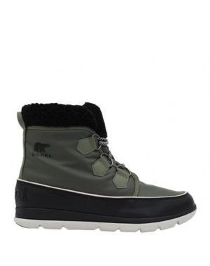 Полусапоги и высокие ботинки SOREL. Цвет: зеленый