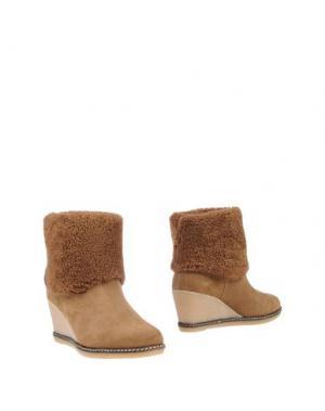 Полусапоги и высокие ботинки JOYKS. Цвет: коричневый
