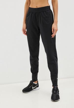 Брюки спортивные Nike W NK ESSNTL PANT WARM. Цвет: черный