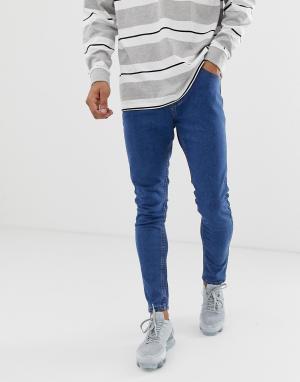 Голубые супероблегающие джинсы Bershka. Цвет: синий