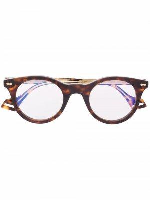 Очки в круглой оправе черепаховой расцветки Gucci Eyewear. Цвет: коричневый