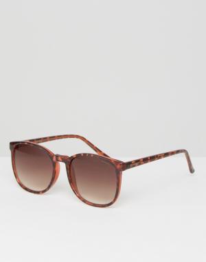 Солнцезащитные очки в круглой черепаховой оправе Urkel Komono. Цвет: коричневый