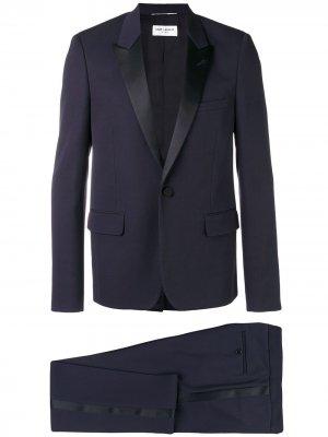Деловой костюм с пиджаком заостренными лацканами Saint Laurent. Цвет: синий