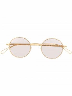 Солнцезащитные очки Brenda в круглой оправе Mykita. Цвет: золотистый