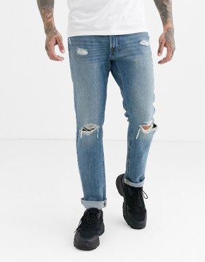 Выбеленные узкие джинсы с состаренной отделкой Abercrombie & Fitch. Цвет: синий