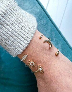 Набор из трех золотистых браслетов-каффов с украшениями в виде небесных тел -Золотистый ASOS DESIGN