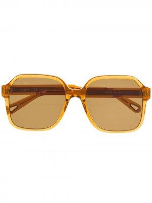 Солнцезащитные очки в массивной квадратной оправе Chloé Eyewear. Цвет: оранжевый