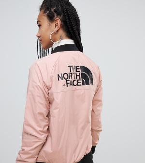 Розовый утепленный бомбер The North Face. Цвет: розовый