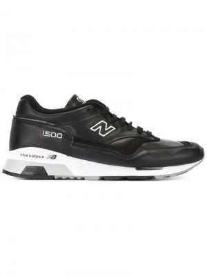 Кроссовки с панельным дизайном New Balance. Цвет: черный