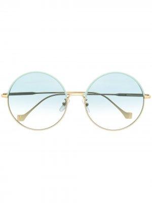 Солнцезащитные очки в массивной круглой оправе LOEWE. Цвет: золотистый