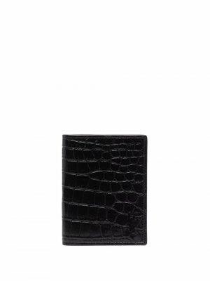 Кошелек с тиснением под кожу крокодила и логотипом Saint Laurent. Цвет: черный