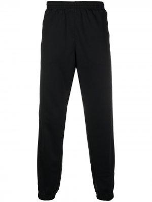 Спортивные брюки из джерси Nike. Цвет: черный