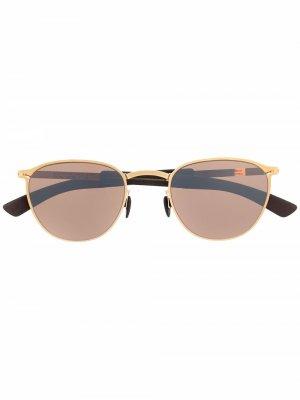 Солнцезащитные очки Clove в овальной оправе Mykita. Цвет: золотистый