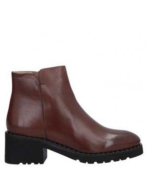 Полусапоги и высокие ботинки CALPIERRE. Цвет: какао