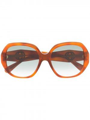 Солнцезащитные очки в массивной круглой оправе Gucci Eyewear. Цвет: коричневый