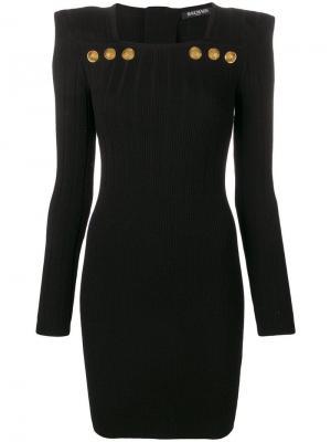 Трикотажное приталенное платье мини Balmain. Цвет: черный