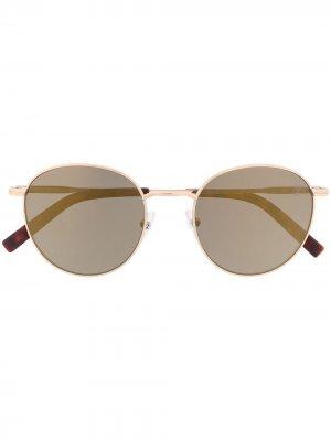 Солнцезащитные очки в массивной оправе Timberland. Цвет: золотистый