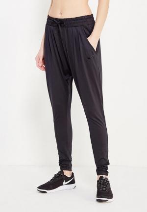 Брюки спортивные Nike Womens Dry Flow Lux Pants. Цвет: черный