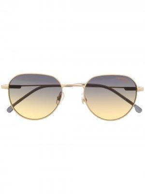 Солнцезащитные очки в круглой оправе Carrera. Цвет: золотистый