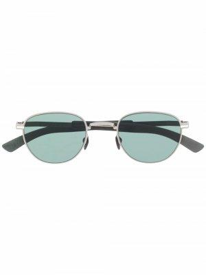 Солнцезащитные очки в круглой оправе Mykita. Цвет: серебристый