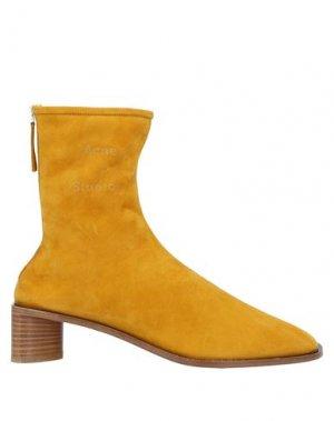 Полусапоги и высокие ботинки ACNE STUDIOS. Цвет: охра