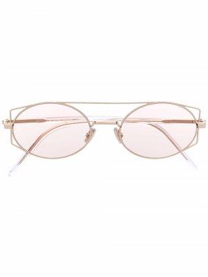Солнцезащитные очки в геометричной оправе Dior Eyewear. Цвет: золотистый