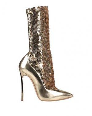 Полусапоги и высокие ботинки CASADEI. Цвет: золотистый