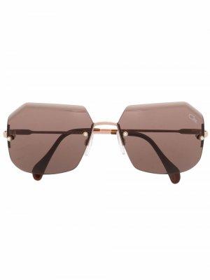 Солнцезащитные очки в безободковой оправе Cazal. Цвет: розовый
