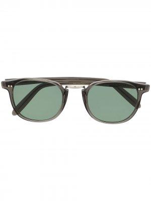 Солнцезащитные очки в овальной оправе Cutler & Gross. Цвет: серый