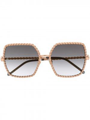 Солнцезащитные очки в фактурной массивной оправе Elie Saab. Цвет: золотистый