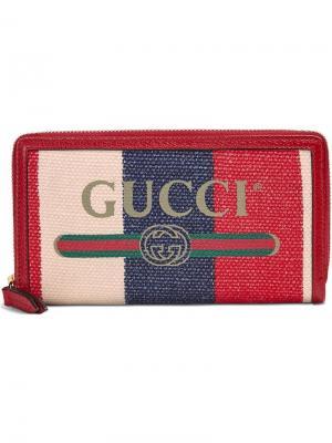Кошелек с круговой молнией и принтом логотипа Gucci. Цвет: красный