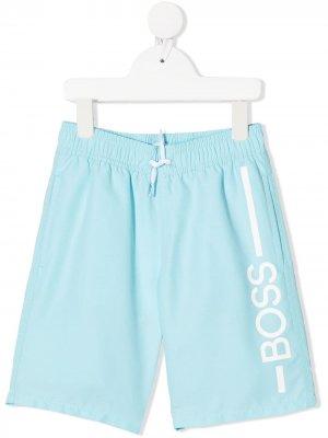 Плавки с логотипом BOSS Kidswear. Цвет: синий