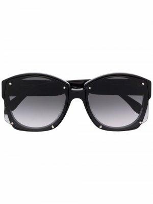 Солнцезащитные очки в массивной круглой оправе Alexander McQueen Eyewear. Цвет: черный