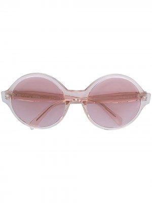 Солнцезащитные очки в массивной круглой оправе Celine Eyewear. Цвет: розовый